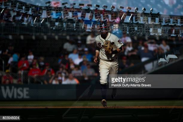 A double exposure of Dansby Swanson of the Atlanta Braves during the game against the Milwaukee Brewers at SunTrust Park on June 24 2017 in Atlanta...
