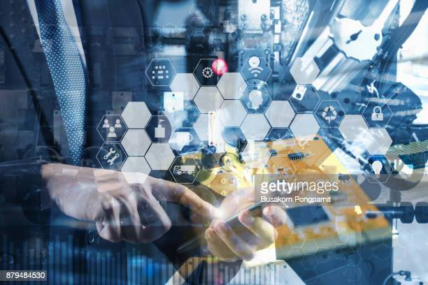 double exposure of engineer or technician man with business industrial tool icons, enguneer using tablet with industrial business concept. industry 4.0 concept - automation stock pictures, royalty-free photos & images