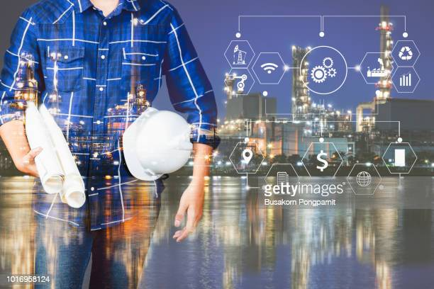 double exposure of engineer with oil refinery industry plant background, industrial instruments in the factory and physical system icons concept, industry 4.0 concept image - building icon stock photos and pictures