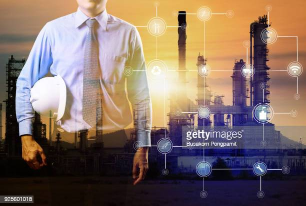 Double exposure of Engineer with oil refinery industry power plant background, industrial instruments in the factory and physical system icons concept, Industry 4.0 concept image