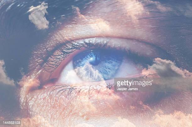 double exposure of eye and sky