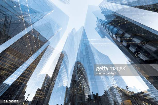 double exposure of futuristic skyscrapers in london city - skyline stock pictures, royalty-free photos & images