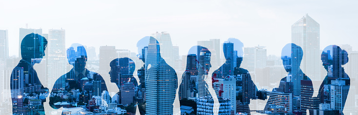 Double exposure of group of businessperson and cityscape. 1152955424
