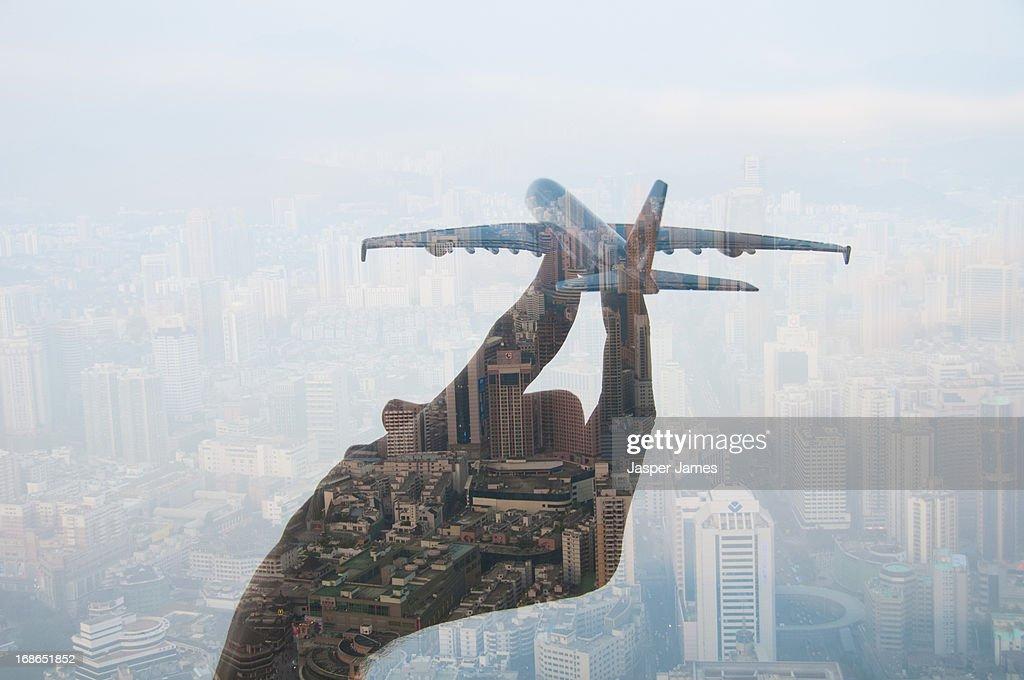 double exposure of hand holding model plane : Stock Photo