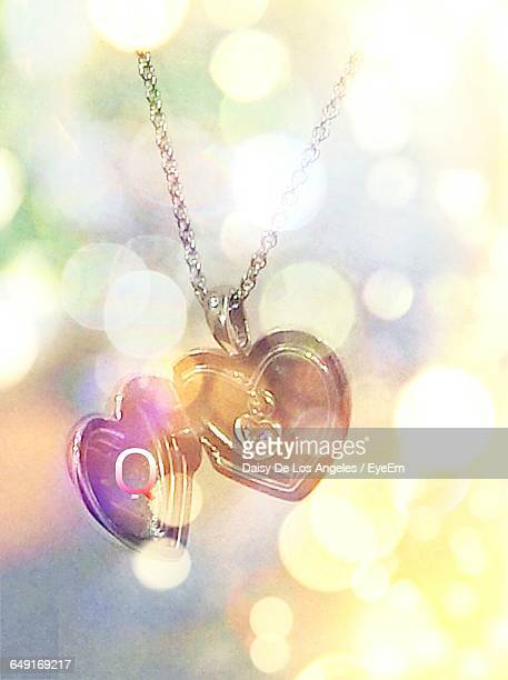 Double Exposure Of Heart Shape Pendant Necklace And Illuminated Glowing Lights