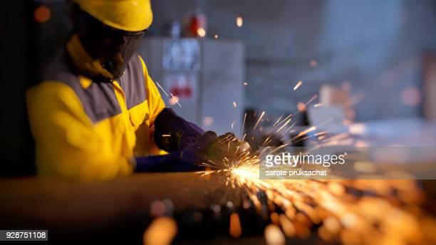double exposure of industrial worker at the factory . - saúde e segurança ocupacional - fotografias e filmes do acervo