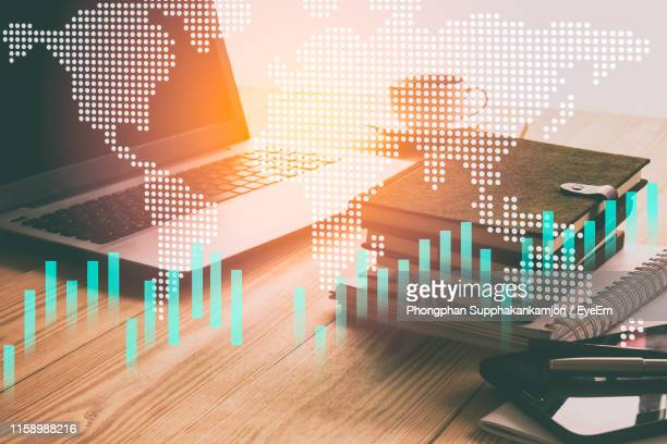 double exposure of laptop and graph - finanzwirtschaft und industrie stock-fotos und bilder