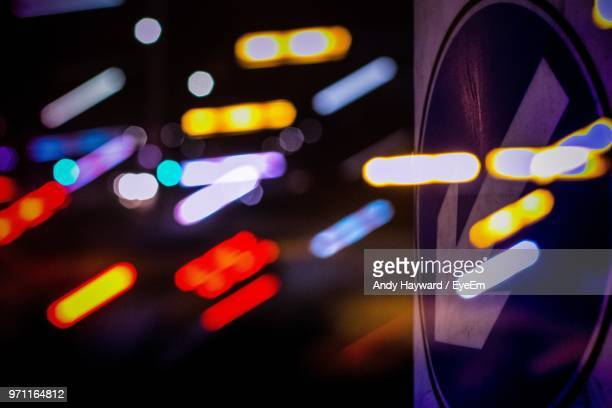 double exposure of lights with arrow symbol - double arrow stock pictures, royalty-free photos & images