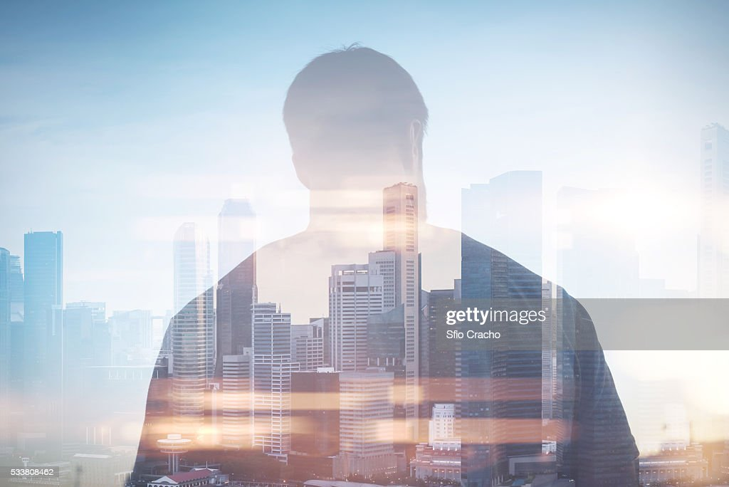Double exposure of man against cityscape : Foto stock