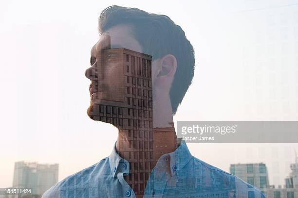 double exposure of man and buildings