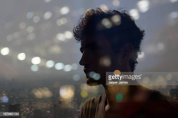 double exposure of man and cityscape