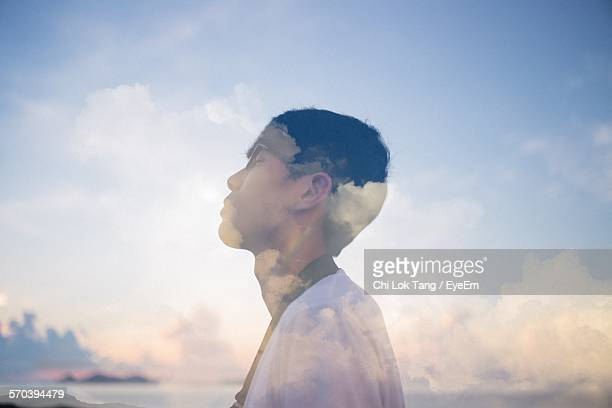 Double Exposure Of Man And Clouds