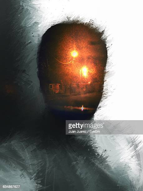 Double Exposure Of Man And Illuminated Street Lights At Night