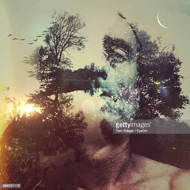 Double Exposure Of Man And Trees During Sunset