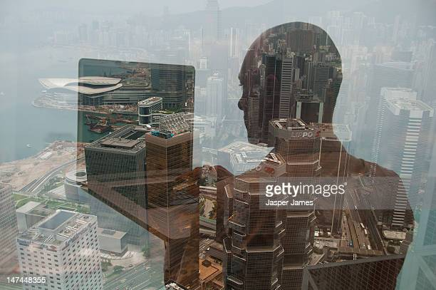 double exposure of  man using laptop