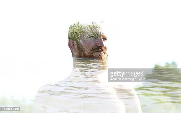 Double Exposure Of Man With Plants In Lake