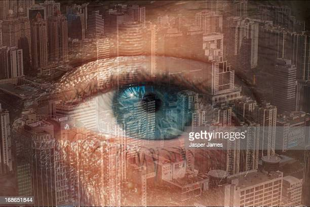 double exposure of mans eye and cityscape