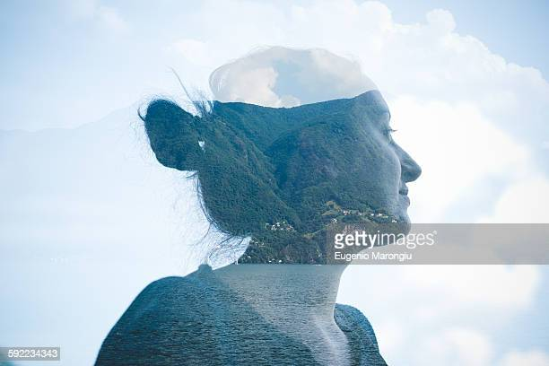 double exposure of mid adult woman at lake lugano, switzerland - mehrfachbelichtung stock-fotos und bilder