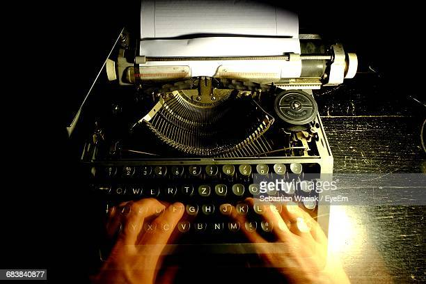 Double Exposure Of Person Typing On Old Typewriter