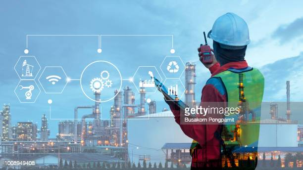double exposure of technician engineer with safety helmet with oil refinery industry plant background - gas stock pictures, royalty-free photos & images