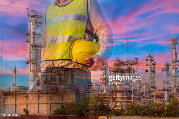 double exposure of technician engineer with safety helmet with oil refinery industry plant  background - greenpeace stock pictures, royalty-free photos & images