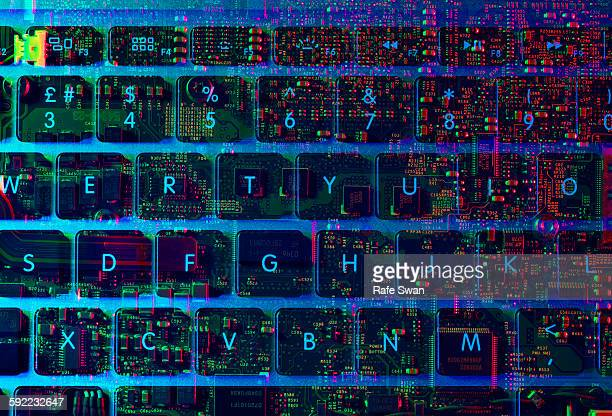 Double exposure of the inside and out of a laptop computer showing the electronic components under the keyboard