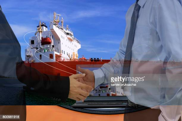 Double exposure of Two Businessman  handshake for for Business corporate.Logistic Import Export background .