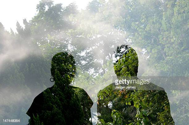 double exposure of two people and trees
