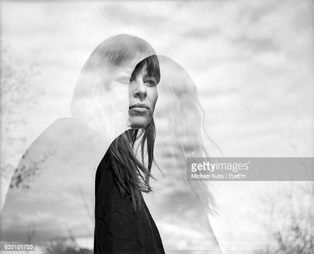 double exposure of woman against sky - mehrfachbelichtung stock-fotos und bilder