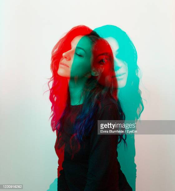 double exposure of woman against white background - multiple exposure stock pictures, royalty-free photos & images