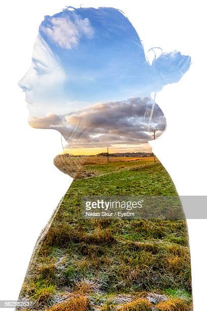 Double Exposure Of Woman Against White Background
