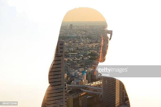 double exposure of woman and cityscape at sunset - 多重露出 ストックフォトと画像