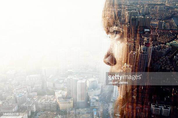 double exposure of woman and cityscape - erin james stock-fotos und bilder