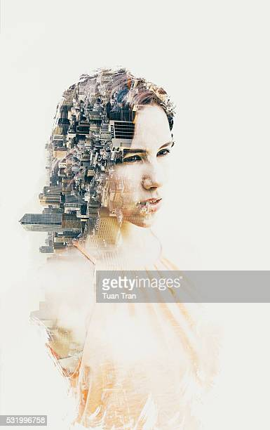 Double exposure of woman and cityscape