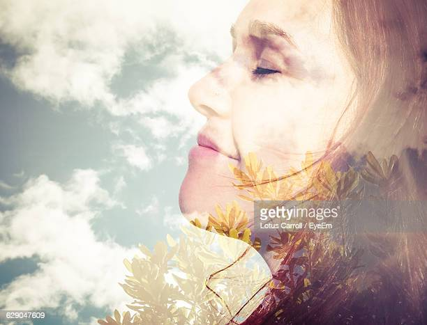 Double Exposure Of Woman And Cloudy Sky