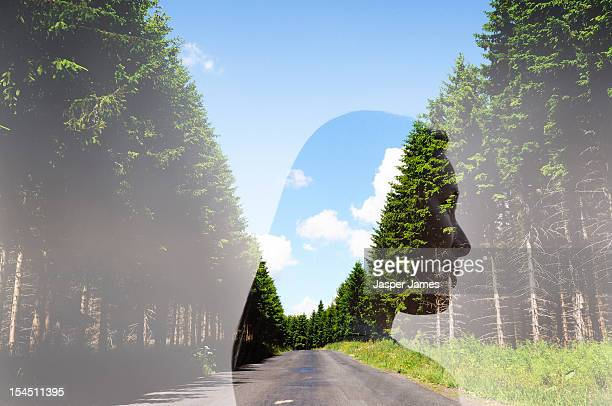 double exposure of woman and country road