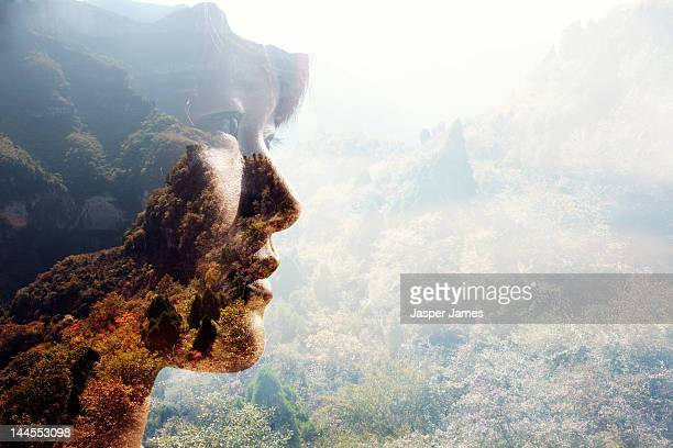 double exposure of woman and nature - erin james stock-fotos und bilder