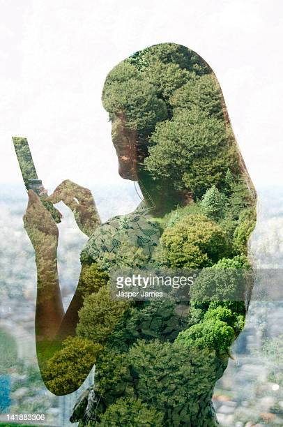 double exposure of woman and trees
