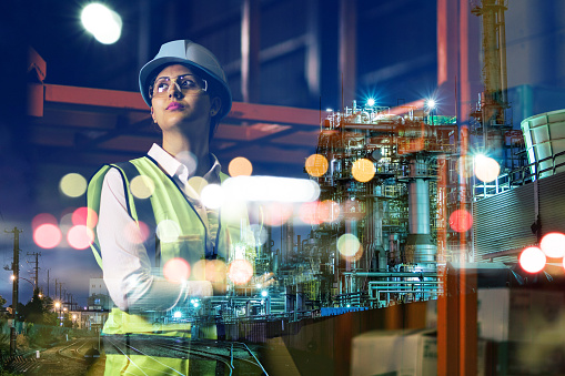double exposure of woman labor and factory exterior. industrial technology concept. 858529688