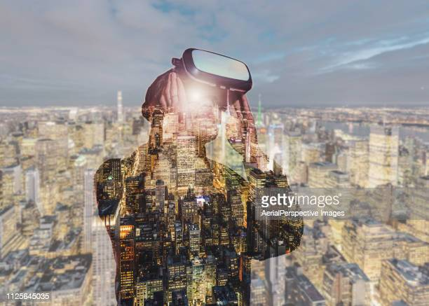 double exposure of woman trying virtual reality simulator glasses headset - digital composite stock pictures, royalty-free photos & images