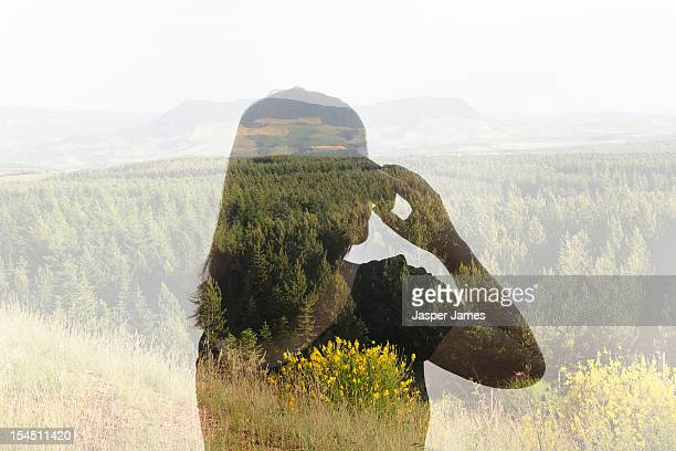 double exposure of woman using mobile phone