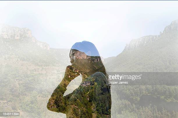 double exposure of woman using phone and nature