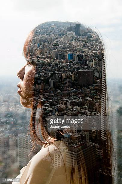 double exposure of woman's head and cityscape