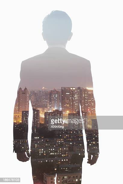 Double exposure of young businessman and the skyline of Shanghai, China