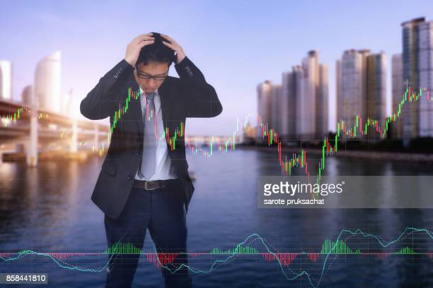 Double exposure of Young businessman his declining share. Bad business, economy in recession!
