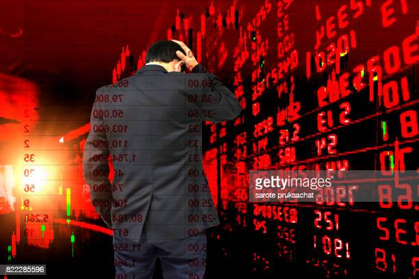 Double exposure of Young businessman his declining shares. Bad business, economy in recession!