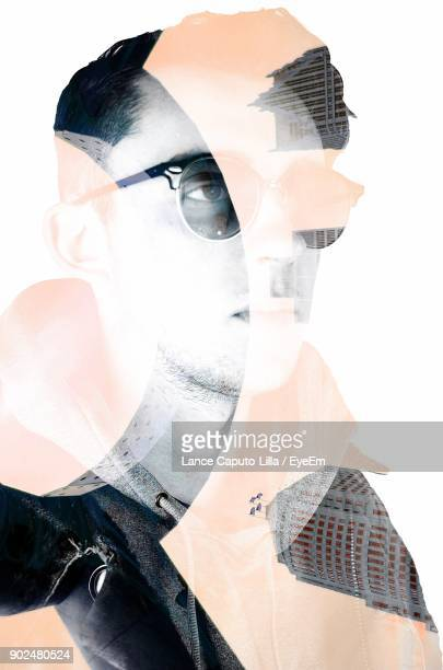 double exposure of young man and buildings over white background - caputo foto e immagini stock