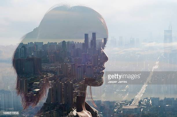 double exposure of young woman and cityscape