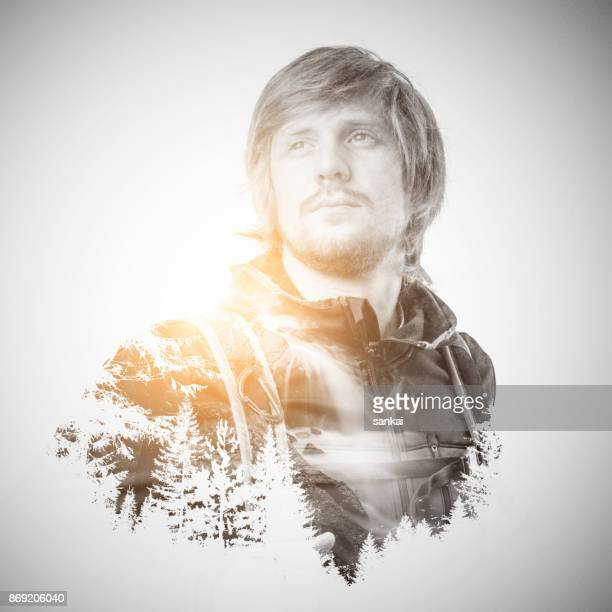 double exposure portrait of a male traveler. - remote location stock pictures, royalty-free photos & images
