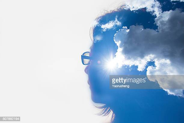 Double exposure portrait of Asian girl and blue sky